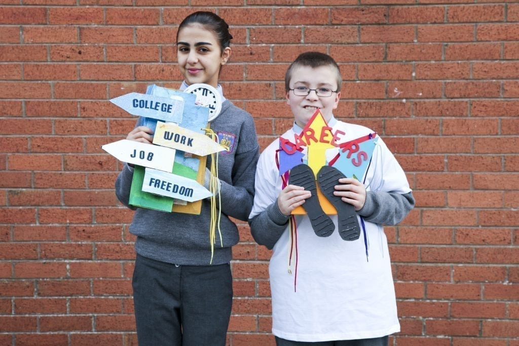 Two students from St Mark's, Tallaght hold signposts about college and careers